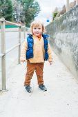 Outdoor portrait of a cute little boy
