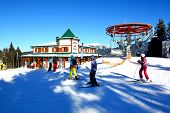 Bukovel, Ukraine - February 17: The Cableway, Skiers And Restaurant In Bukovel. It Is The Largest Sk