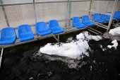 Blue Seats Of Replacement Bench And Dirty Snow
