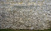 foto of old stone fence  - Ancient stone wall of the castle - JPG