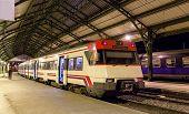 stock photo of suburban city  - Spanish suburban electric train at French border station Cerbere - JPG