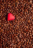 A Red Heart On Coffee Beans