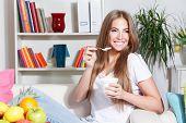 Happy Woman Eating Yogurt