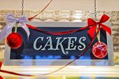 image of cake-ball  - Cakes plate with christmas decorations and red balls and reflections - JPG