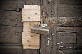 Padlock on wooden door.