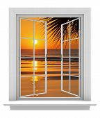 Open window with a tropical beach view and orange sunset