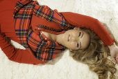 Pretty Blonde Girl In Christmas Red Robe & Laying Down