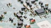 picture of microprocessor  - PCB macro shot with a lot of electrical components - JPG