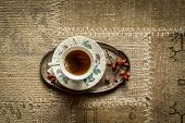 Top View Of Cup Of Tea On Vintage Carpet