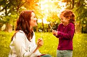 picture of blowing  - Mother with small daughter blowing to dandelion  - JPG