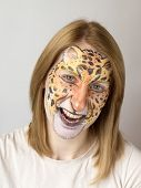 stock photo of panther  - Young blond slav girl with face painting panther - JPG