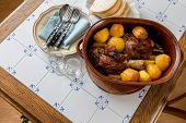 Roasted Meat With Potatoes Served With Bread