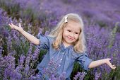 Happy Little Girl In A Lavender