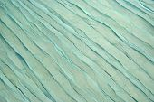 stock photo of aquamarine  - Blue Wavy Aquamarine Fabric Texture Background Close - JPG