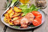 Grilled Pork Cutlets With Baked Potatoes