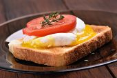 Bread Toasted With Poached Egg And Tomato Slice