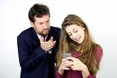 Father Angry With Daughter Playing With Smart Phone