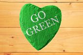 green heart with go green writing