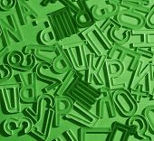cyrllic alphabet letters lying in disorder on white paper background