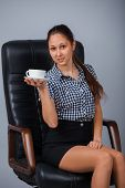 Business woman on a chair