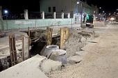 stock photo of hydro  - Hydro construction work reconstruction of sewerage night photo - JPG