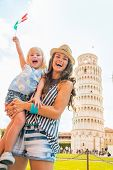 Happy Mother And Baby Girl With Italian Flag In Front Of Leaning
