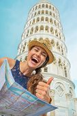 Happy Young Woman With Map In Front Of Leaning Tower Of Pisa Sho