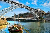 image of dom  - Traditional wine boats and Dom Luis I bridge in Porto Portugal - JPG