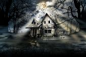 stock photo of chalet  - Haunted house with dark scary horror atmosphere - JPG