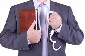 image of sadomasochism  - Businessman holding handcuffs and book - JPG