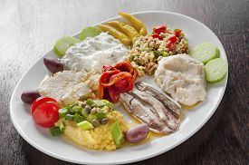 picture of ouzo  - variety of Greek appetizers ouzo meze in dish - JPG