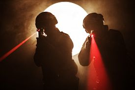picture of police  - Spec ops police officers SWAT in the smoke and fire with laser sights