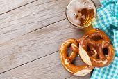 pic of pretzels  - Beer mug and pretzel on wooden table - JPG