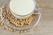image of soybeans  - Soybeans and soy milk in a cup on wooden background - JPG