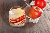 pic of cider apples  - Glass of apple cider with fruits on wooden background - JPG