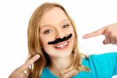 picture of moustache  - Happy teenage woman with a moustache - JPG