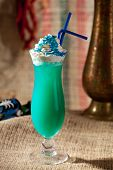 stock photo of curacao  - Blue Curacao Alcohol Cocktail with White Cream - JPG