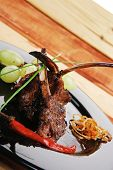 picture of chive  - served ribs over wooden table with chives and grapes - JPG