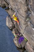 picture of climbing wall  - Climbing partners make ascent on to the rock wall Two climbers  - JPG