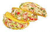 picture of fill  - Chicken and salad filled crispy taco shells isolated on a white background - JPG