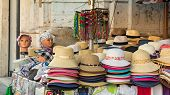 foto of stall  - a stall of hats on the road - JPG