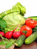 picture of rocket salad  - Fresh vegetables radishes tomatoes cucumbers cabbage rocket salad on sacking background isolated on white - JPG