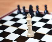 stock photo of chessboard  - Winner with his team on a chessboard - JPG