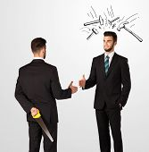 foto of backstabbers  - Ruthless businessman hiding a weapon white drawn beating hammer marks - JPG