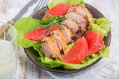 picture of roast duck  - Roast duck breast with lettuce and grapefruit on a plate - JPG