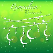 stock photo of eid al adha  - Card with garland for congratulations with beginning of fasting month of Ramadan as well with Islamic holiday Eid al - JPG