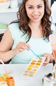 Portrait Of A Bright Young Mother Preparing Food For Her Baby In The Kitchen