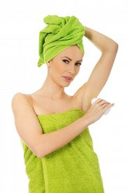 pic of deo  - Young woman wrapped in towel using deodorant - JPG