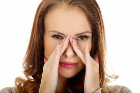 foto of sinuses  - Woman suffering from sinus pressure pain - JPG