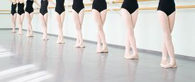 pic of classic art  - legs of young dancers ballerinas in class classical dance ballet - JPG